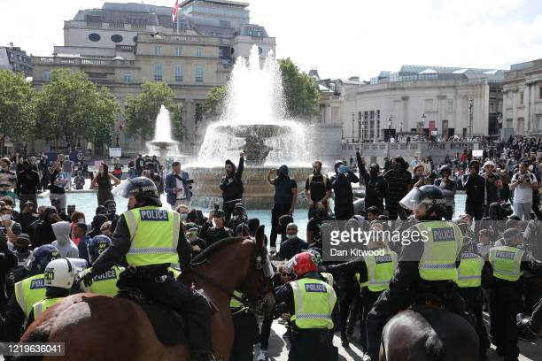 Police on horseback keep watch near the National Gallery during a protest on June 13, 2020 in London, United Kingdom. Following a social media post...