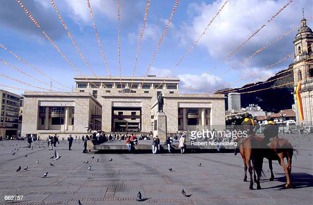 Police on horseback keep watch over the Ministry of Justice Building at Plaza Bolivar August 22 2000 in Bogota Colombia