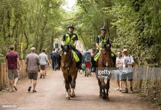 Police on horseback patrol on day 2 of the Glastonbury Festival 2017 at Worthy Farm Pilton on June 23 2017 in Glastonbury England