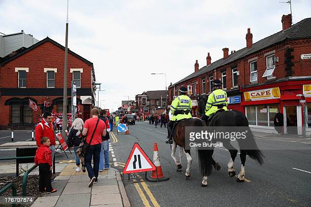 Police on horseback patrol the streets around Anfield stadium as fans make their way to the Barclays Premier League match between Liverpool and Stoke...