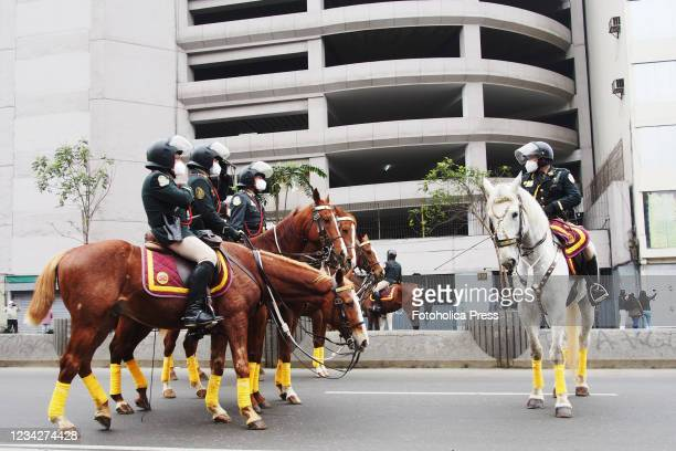 Police on horseback patrolling the city, when on the day of Pedro Castillo's presidential inauguration his supporters take to the streets to demand a...