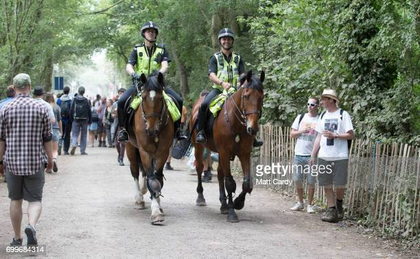 Police on horses patrol the Glastonbury Festival site at Worthy Farm in Pilton on June 22 2017 near Glastonbury England The largest greenfield...