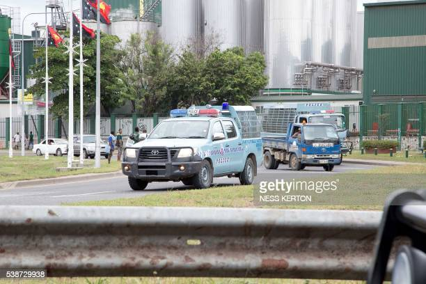 Police on patrol ask people to get off the roads following a protest rally by the students in Port Moresby on June 8 2016 Police in Papua New Guinea...