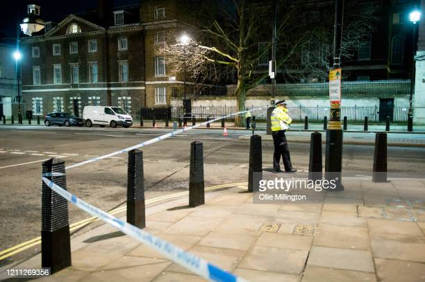 Police on the cordon line of the scene where a man has been shot dead by police in whitehall overnight on March 9, 2020 in London, England. It has...