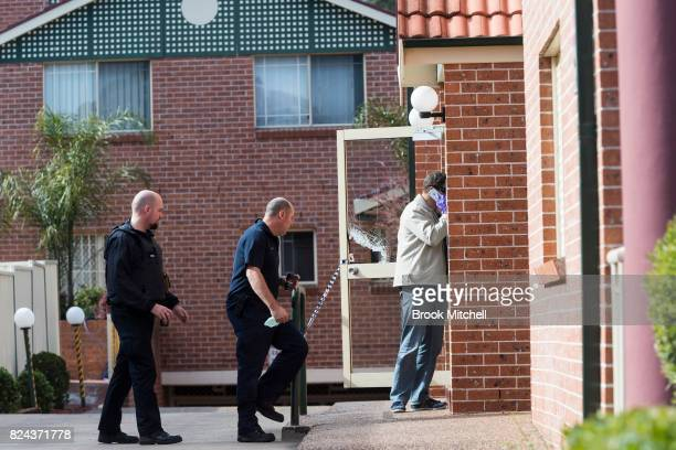 Police on the scene at an apartment complex in Sproule Street Lakemba the scene of an overnight terror raid on July 30 2017 in Sydney Australia...