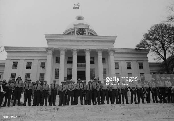 Police on the steps of the Alabama State Capitol in Montgomery at the culmination of the Selma to Montgomery march March 1965