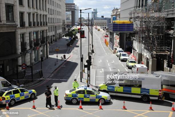 Police operate a cordon on the North side of London Bridge as forensic officers work after last night's terrorist attack on June 4 2017 in London...