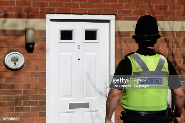 Police outside a property on Navigation Way in Hockley Birmingham after further arrests were made in connection with the Westminster attack