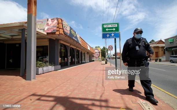 Police outside the Woodville Pizza Bar after it was announced the a worker from the shop lied to authorities during a Covid investigation, causing...
