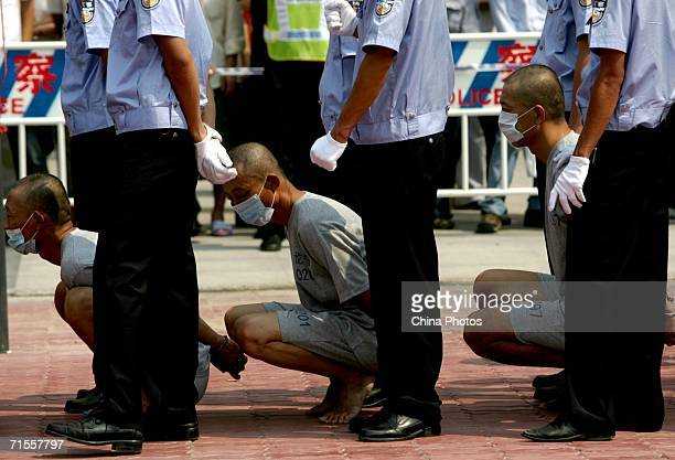 Police parade convicted criminals during a public sentence August 1 2006 in Shenzhen of Guangdong Province China The local authorities have launched...