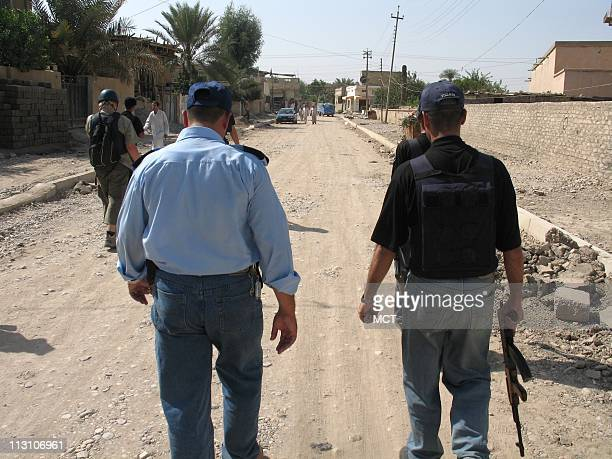 BAQUBAH IRAQ Police partol the streets of Baquba on the eve of a constitutional vote October 14 2005 Police called the city calm but still went out...