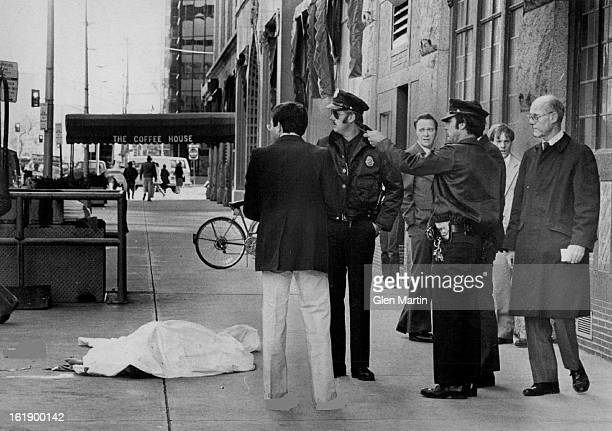 OCT 24 1980 Police Passersby Gather Near Draped Body of Denver Man on Sidewalk The man fell to his death Thursday afternoon from the seventh floor of...