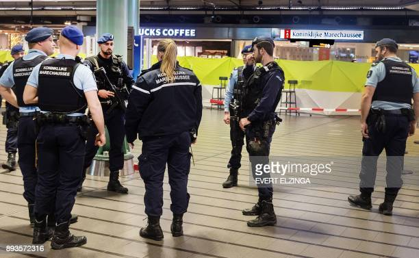 Police patrol after a man wielding a knife was shot by military police on December 15 2017 at Schiphol Airport in Amsterdam Dutch military police on...