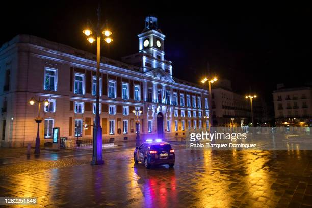 Police patrol along Puerta del Sol Square on the first night of a countrywide curfew on October 25, 2020 in Madrid, Spain. Spain has declared a...