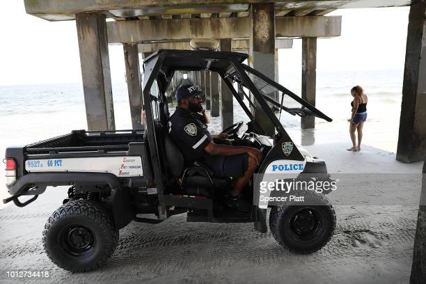 Police patrol along the beach at Coney Island on a hot summer afternoon on August 7 2018 in the Brooklyn borough of New York City New York City is...