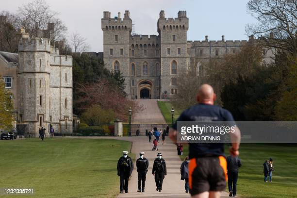 Police patrol along the Long Walk by Windsor Castle in Windsor, west of London, on April 16 following the April 9 death of Britain's Prince Philip,...