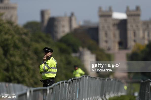Police patrol along the Long Walk outside Windsor Castle in Windsor on May 17 2018 two days before the royal wedding of Prince Harry and Meghan...
