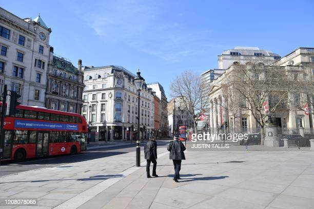 Police patrol around Trafalgar Square in central London on March 24 2020 after Britain ordered a lockdown to slow the spread of the novel coronavirus...