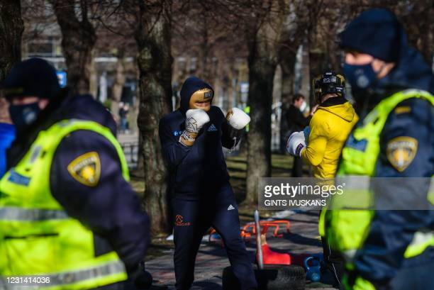 Police patrol as boxers take part in an open air training as a protest form against coronavirus restrictions to remind the government that sport...