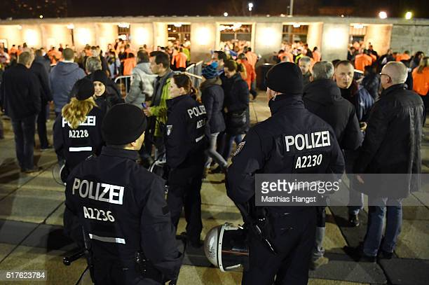Police patrol as fans enter the ground prior to the International Friendly match between Germany and England at Olympiastadion on March 26 2016 in...