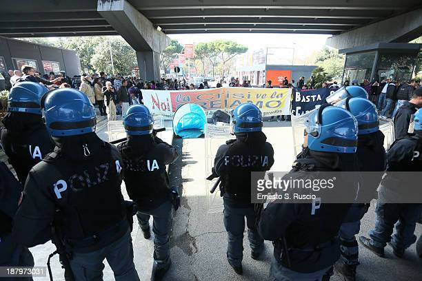 Police patrol as fans wait while protestors surround the area before 'The Hunger Games Catching Fire' Premiere during 8th Rome Film Festival at the...