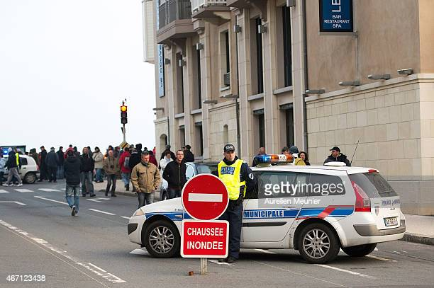 Police patrol as people gather on the boardwalk in SaintMalo coast for 'Tide Of The Century' on March 21 2015 in SaintMalo France SaintMalo is famous...