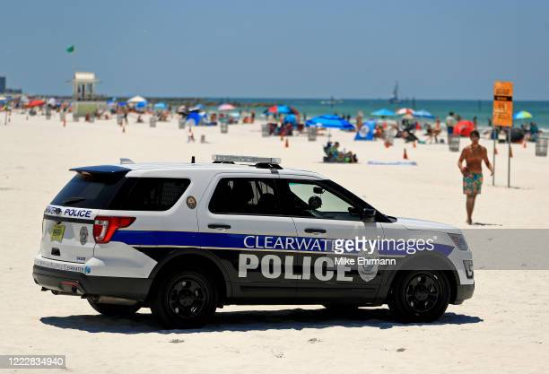 Police patrol as people visit Clearwater Beach after Governor Ron DeSantis opened the beaches at 7am on May 04, 2020 in Clearwater, Florida....