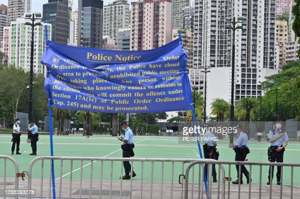Police patrol at Victoria Park in the Causeway Bay district of Hong Kong on June 4 after closing the venue where Hong Kong people traditionally...