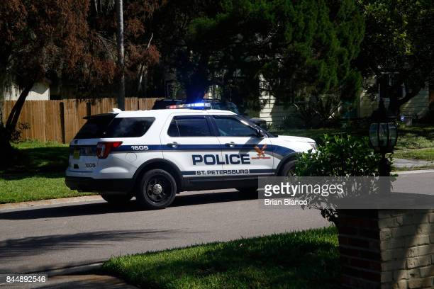A police patrol car drives through a residential neighborhood announcing over the loud speaker that a mandatory evacuation has been issued for the...