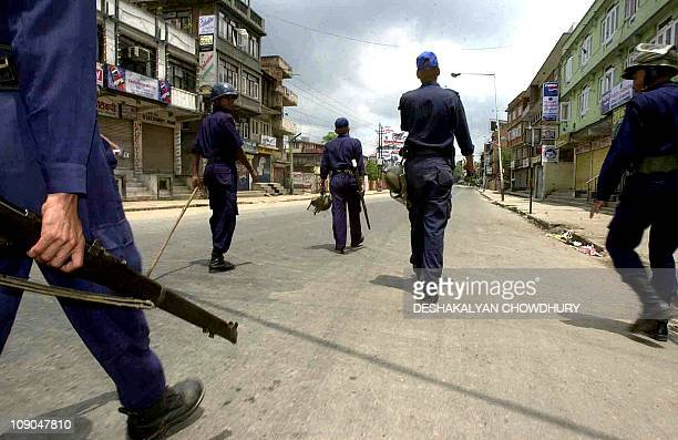 Police patrol deserted streets as a curfew is imposed in Kathmandu 05 June 2001 the day after at least two people died in violent protests that swept...