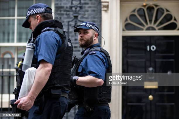 Police patrol Downing Street ahead of the daily Coronavirus briefing on April 12 2020 in London England Prime Minister Boris Johnson spent a week at...
