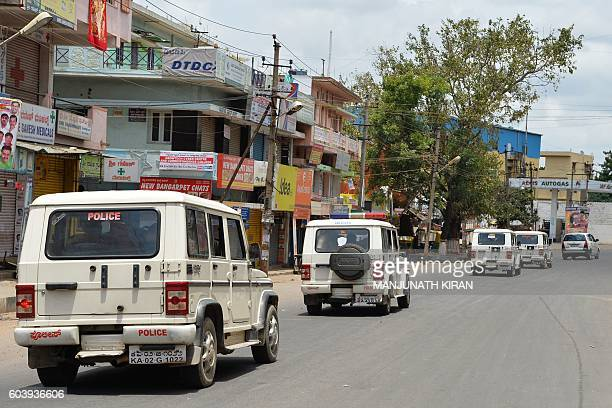 Police patrol during a curfew following violence in the city due to the Cauvery water sharing dispute with neighbouring state Tamil Nadu in Bangalore...