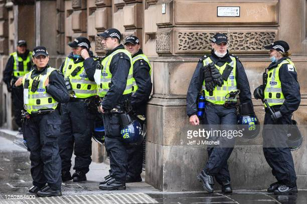 Police patrol George Square as former military personnel stand in front of the cenotaph on June 27, 2020 in Glasgow, Scotland. Activists have...