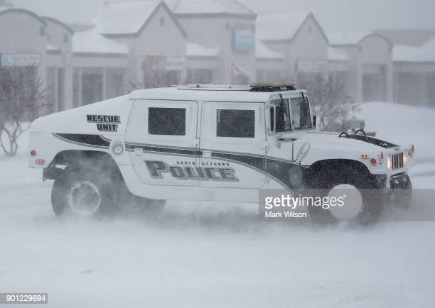 Police Patrol in a Humvee as a storm passes the area on January 4 2018 in South Bethany Delaware A winter storm is traveling up the east coast of the...