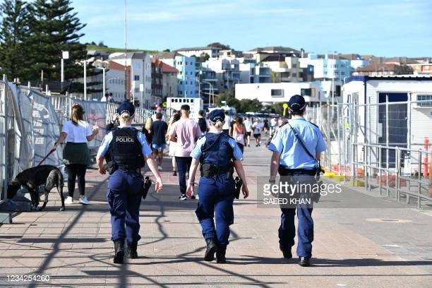 Police patrol near Bondi Beach in Sydney on July 28 as authorities announced that millions of residents will spend another month in lockdown due to a...