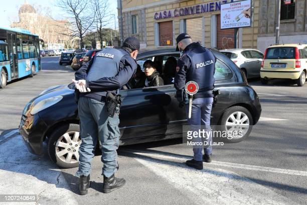 Police patrol of the Ostia Commissariat checks if the occupants of a car are respecting the quarantine on March 15, 2020 in Rome, Italy. Ostias...