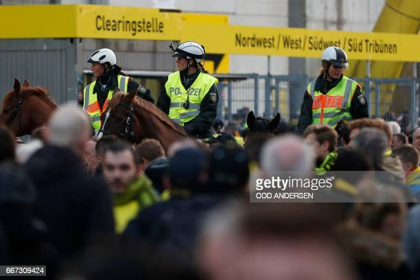 TOPSHOT Police patrol on horseback outide the stadium after the team bus of Borussia Dortmund had some windows broken by an explosion some 10km away...
