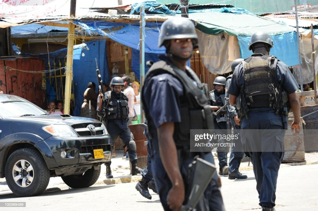 Police patrol on May 24, 2010 in Kingston, Jamaica after two police officers were killed after coming under attack amid spreading unrest despite a state of emergency imposed by the government. Six police were wounded in the incident on Sunday after police responded to a call for help from a female motorist, the Jamaican police force's Constabulary Communications Network said. It said the two police officers died after being taken to the University of the West Indies Hospital. Jamaica's prime minister vowed tough action against a frenzy of gang violence in Kingston, imposing a state of emergency to curb armed supporters of an alleged druglord sought by the United States.