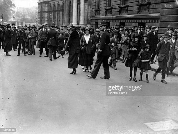 Police patrol onlookers on a London street during the General Strike of 1926