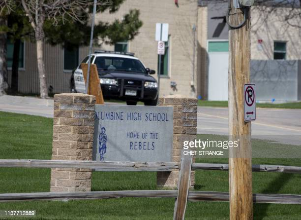 Police patrol outside a locked Columbine High School on April 17 2019 in Littleton Colorado as all Denverarea schools were evacuated and classes...
