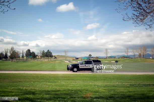 Police patrol outside Columbine High School on April 17 2019 in Littleton Colorado as all Denverarea schools were evacuated and classes cancelled...