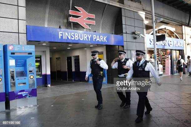 Police patrol outside Finsbury Park station in north London after a vehichle hit pedestrians on June 19 2017 A van ploughed into pedestrians near a...