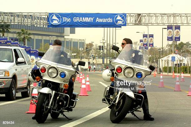 Police patrol outside Staples Center before the 44th Annual Grammy Awards February 27 2002 in Los Angeles CA