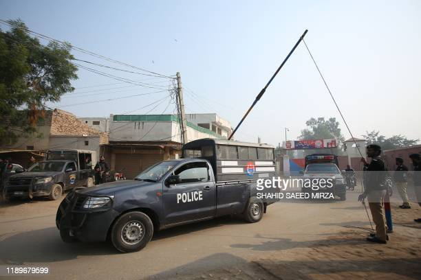 Police patrol outside the central jail, as the court delivered the verdict on a blasphemy case, in Multan on December 21, 2019. - A Pakistani court...