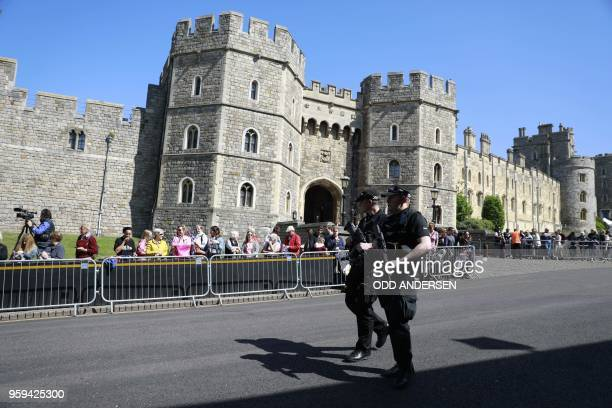 Police patrol outside the Henry VIII Gate at Windsor Castle in Windsor on May 17 2018 two days before the royal wedding of Prince Harry and Meghan...
