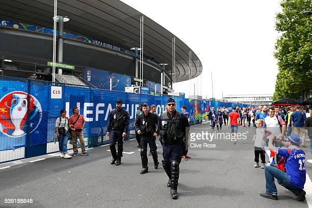 Police patrol outside the stadium prior to kickoff during the UEFA Euro 2016 Group A match between France and Romania at Stade de France on June 10...