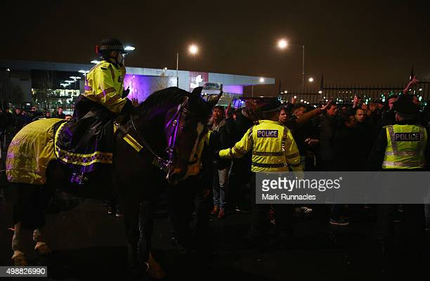 Police patrol outside the stadium prior to the UEFA Europa League Group A match between Celtic FC and AFC Ajax at Celtic Park on November 26, 2015 in...