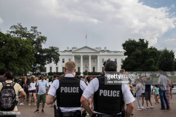 Police patrol outside the White House on August 11 2018 in Washington DC A 'Unite the Right' rally featuring white supremacist forces and counter...