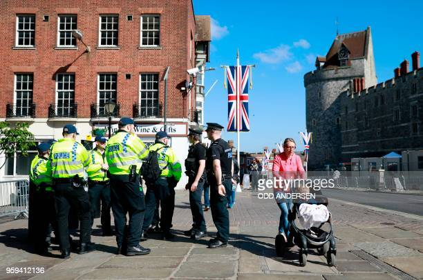 Police patrol outside Windsor Castle in Windsor on May 17 2018 two days before the royal wedding of Prince Harry and Meghan Markle Britain's Prince...