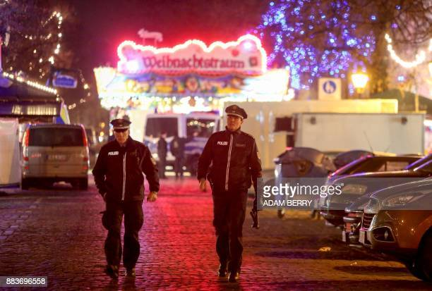 Police patrol the area after an explosive was found at Christmas market in Potsdam near Berlin Germany on December 1 2017 German police were...